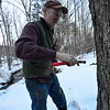 KRISTOPHER RADDER - BRATTLEBORO REFORMER<br /> Jerry Smith, of Deer Ridge Farm, in Guilford, taps a couple of maple trees on Monday, Feb. 26, 2018.