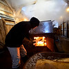 KRISTOPHER RADDER - BRATTLEBORO REFORMER<br /> Stuart Holderness puts wood into the fire as they boil the sap on Monday, Feb. 26, 2018.