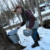 Crews at  Deer Ridge Farm, in Guilford,  works on making maple syrup on Monday, Feb. 26, 2018.
