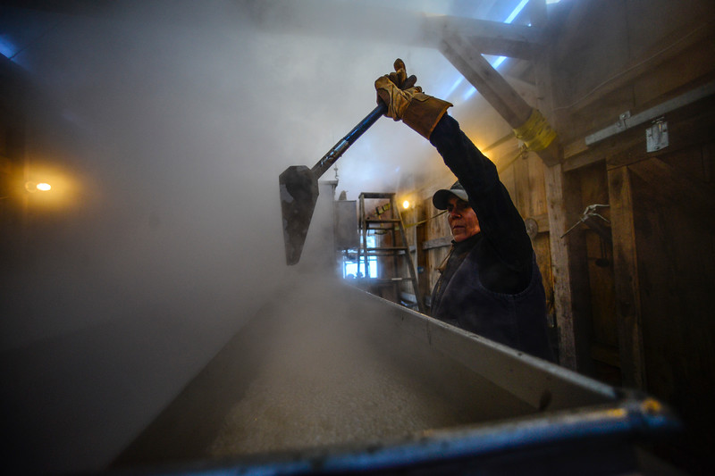 KRISTOPHER RADDER - BRATTLEBORO REFORMER<br /> Susan Peters, of Deer Ridge Farm, in Guilford,  checks out the syrup as it boils on Monday, Feb. 26, 2018.