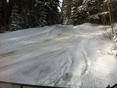 First gate on Wheelerville Road.  Buckling Trail parking lot to the right. No snowmobile parking allowed here.