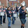 Mason Middle School band marches in place waiting to turn the corner into the Jr. Daffodil Parade.