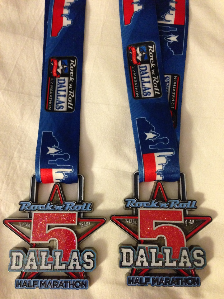 Close up of the medals.  This was the 5th anniversary of the Dallas 1/2 marathon and nice to see they incorporated that in the medal.