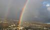 Rainbow over the Paula Drive section of Maunalani Heights, with Waialae Nui and Waialae Iki Ridges beyond.