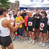 Five minutes before 8am, Dean greets the 35 runners and goes over ground rules: 10 minute miles, run loose, have fun. The bibs all were numbered '6' for the 6th marathon Dean would run consecutively.