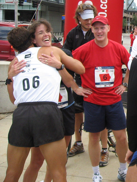 The group crossed the finish line together. Mary became a marathon finisher.
