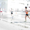 As temperatures rose, fire departments opened the hydrants to cool runners.