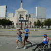 Olympian efforts as runners pass the Coliseum.