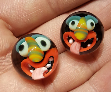 . Pittsburgh-based glass artist Chad Parker makes what he calls Monsterz, marbles with faces. (Chad Parker � Contributed)