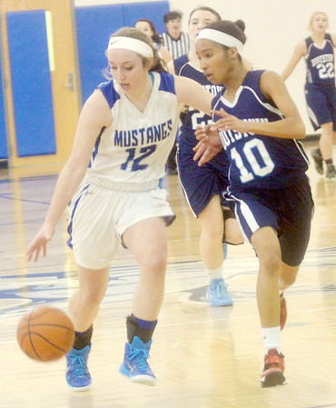 WARREN DILLAWAY / Star Beacon JESSICA VORMELKER (12) of Grand Valley dribbles down court with Monique Jackson of Rootstown defending on Saturday during a Division III sectional championship game at Grand Valley.