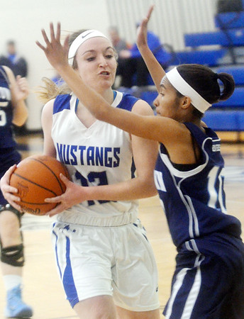 WARREN DILLAWAY / Star Beacon JESSICA VORMELKER (12) of Grand Valley gets fouled by Monique Jackson of Rootstown on Saturday during a Division III sectional championship game at Grand Valley.