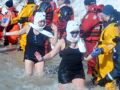 WARREN DILLAWAY / Star Beacon PARTICIPANTS IN the  Polar Bear Plunge, held Saturday at Geneva State Park, slaphands with dive team members. The event raised an estimated $90,000 for Special Olympics Ohio.
