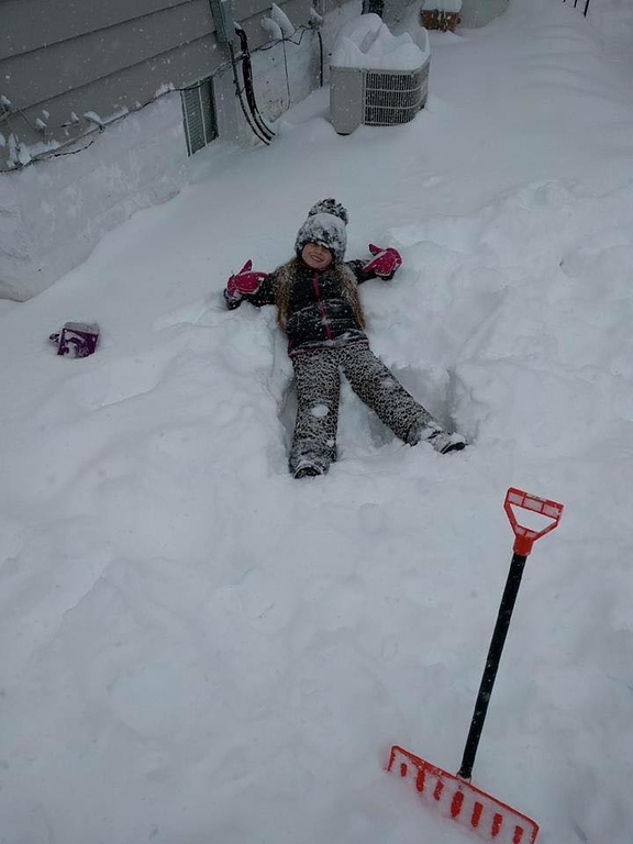 . Photo Courtesy Sara Elizabeth Taking a break from helping dad shovel snow in Oneida on Wednesday, March 15, 2017.