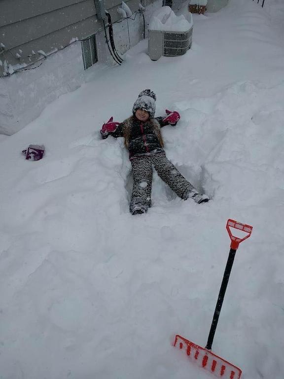 . Photo Courtesy Sara Elizabeth Taking a break from helping dad shovel snow in Oneida on Wednesday, March 15, 2017.