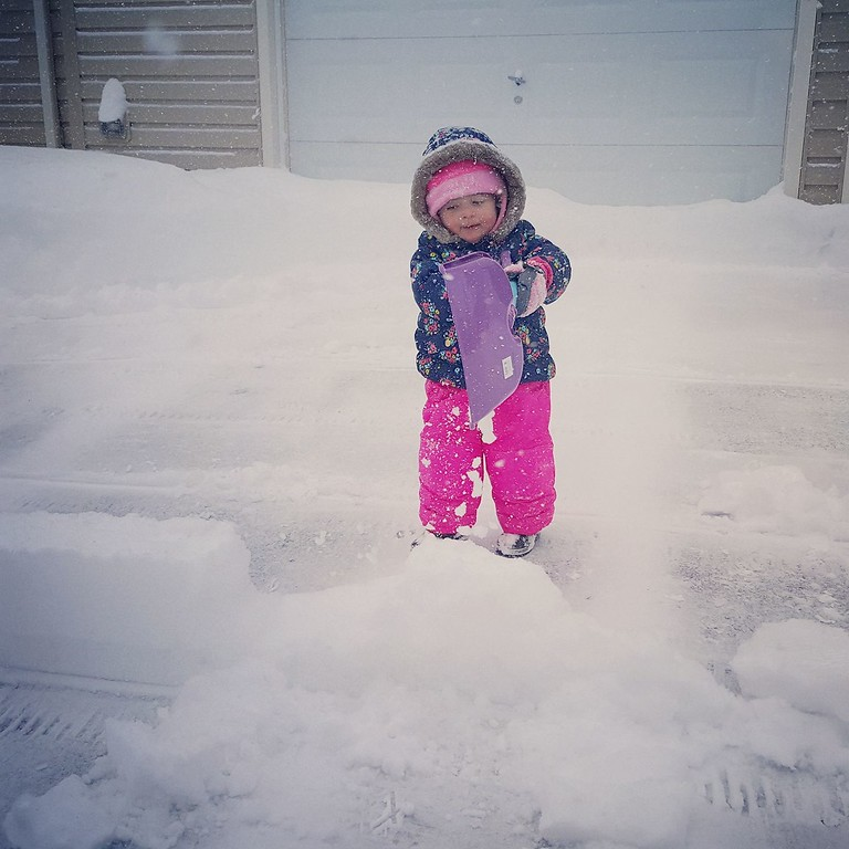 . Photo Courtesy Andrea Brown Helping dad shovel the driveway on Wednesday, March 15, 2017.