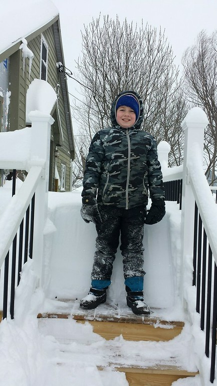 . Photo Courtesy Eugene Bowser Grandson Logan gets ready to take on the 28-plus inches of snow in Vernon Center on Wednesday, March 15, 2017.