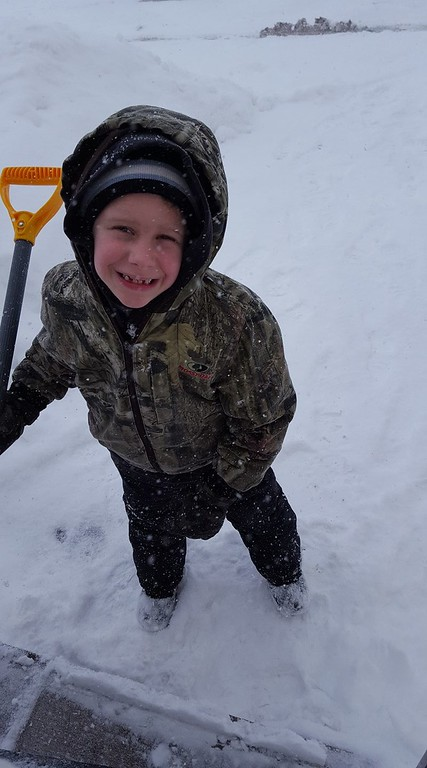 . Photo Courtesy Norma Rutan Happle  Grandson RJ helps out with the shoveling on Wednesday, March 15, 2017.