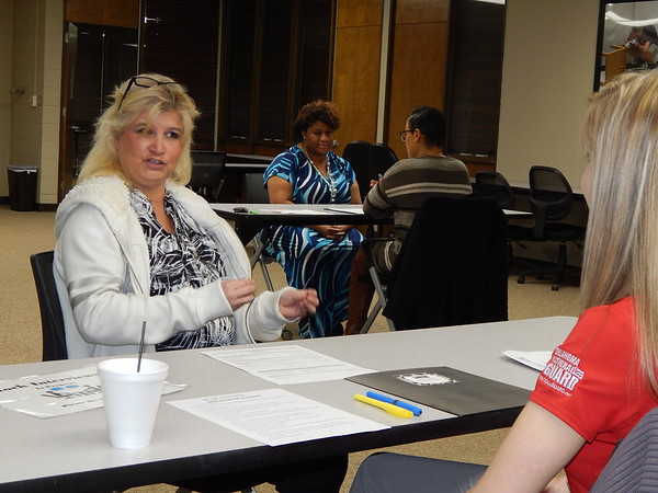 """Staff photo by Cathy Spaulding Indian Capital Technology Center adult student Julia Parkison, left, discusses career goals with """"interviewer"""" Selena Rodden of the Oklahoma National Guard. Potential ICTC graduates are conducting mock job interviews this week."""