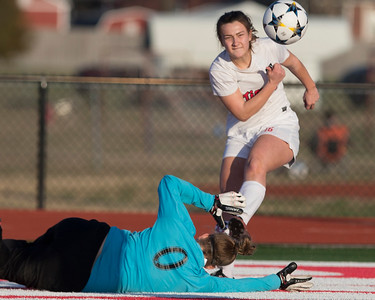 Special photo by Von Castor Fort Gibson's Brooke Hatchett shoots and scores over the arms of Holland Hall goalkeeper Elle Arens Tuesday at Leo Donahue-Tiger Stadium.