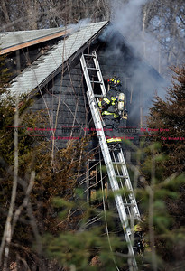 3/3/2016 Mike Orazzi | Staff Farmington firefighters on scene of a house fire on Route 177 Plainville Avenue near the intersection with Route 6 across from Tunxis Community College Thursday afternoon. Smoke was visible from the area of Page Park in Bristol.
