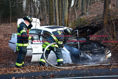 3/3/2016 Mike Orazzi | Staff Bristol firefighters extinguish a car fire on Witches Rock Road in Bristol. No injuries and no hospital transports.