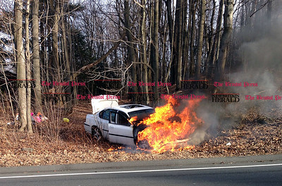 3/3/2016 Photo courtesy of the Bristol Fire Department.  Bristol firefighters extinguish a car fire on Witches Rock Road in Bristol. No injuries and no hospital transports.