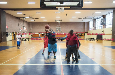 030316   Wesley Bunnell | Staff   2nd floor basketball court at the YMCA in New Britain.  From L - Axel Rosado in white shirt, Shaquan Oldham in blue with the ball and Jonathan Boyd in red sweatshirt all of New Britain.