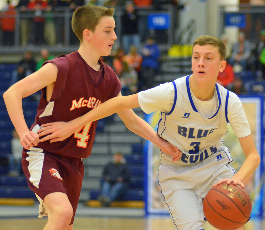 . KYLE MENNIG - ONEIDA DAILY DISPATCH Madison\'s Colton Stone (3) dribbles as McGraw\'s Kevin Shorts (4) defends during the Section III Class D final in Syracuse on Sunday, March 5, 2017.