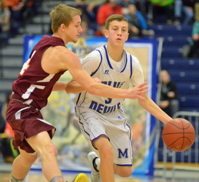 . KYLE MENNIG - ONEIDA DAILY DISPATCH Madison\'s Colton Stone (3) dribbles as McGraw\'s Travis Walker (14) defends during the Section III Class D final in Syracuse on Sunday, March 5, 2017.