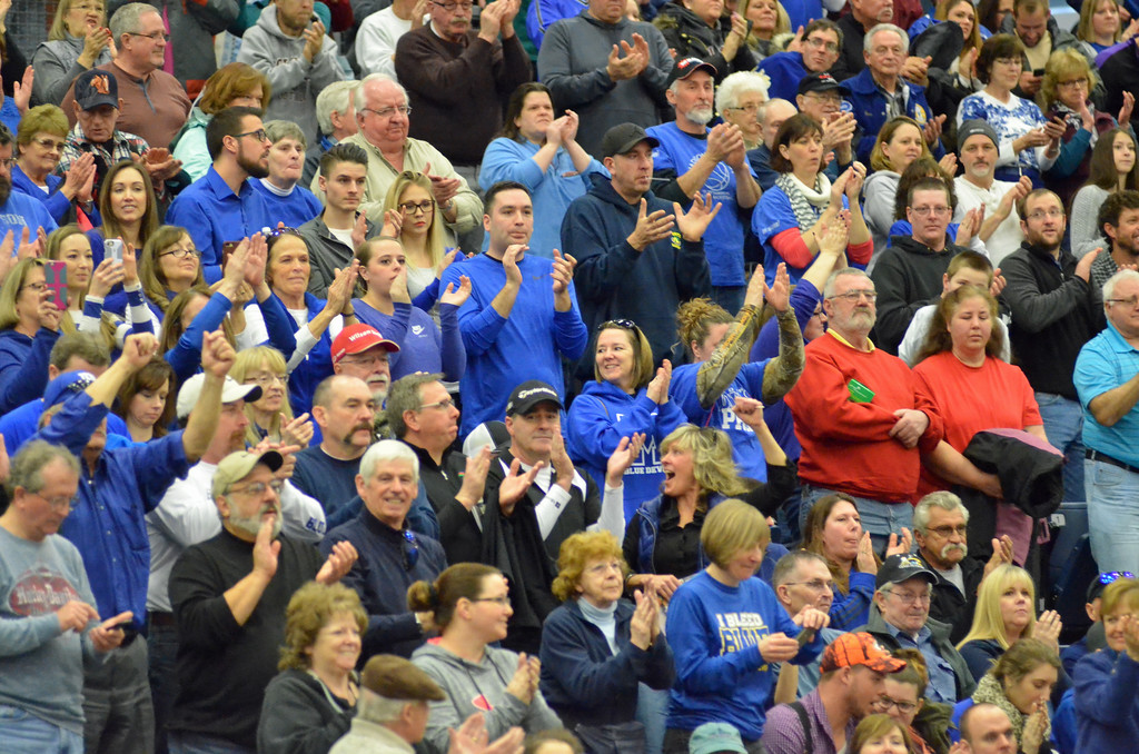 . KYLE MENNIG - ONEIDA DAILY DISPATCH Madison fans cheer after the Blue Devils beat McGraw in the Section III Class D final in Syracuse on Sunday, March 5, 2017.