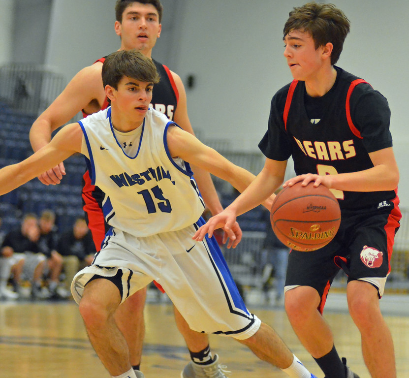 . KYLE MENNIG - ONEIDA DAILY DISPATCH Chittenango\'s Dylan Voutsinas (2) puts down a dribble as Westhill\'s Antonio Scrimale (15) defends during the Section III Class B final in Syracuse on Sunday, March 5, 2017.