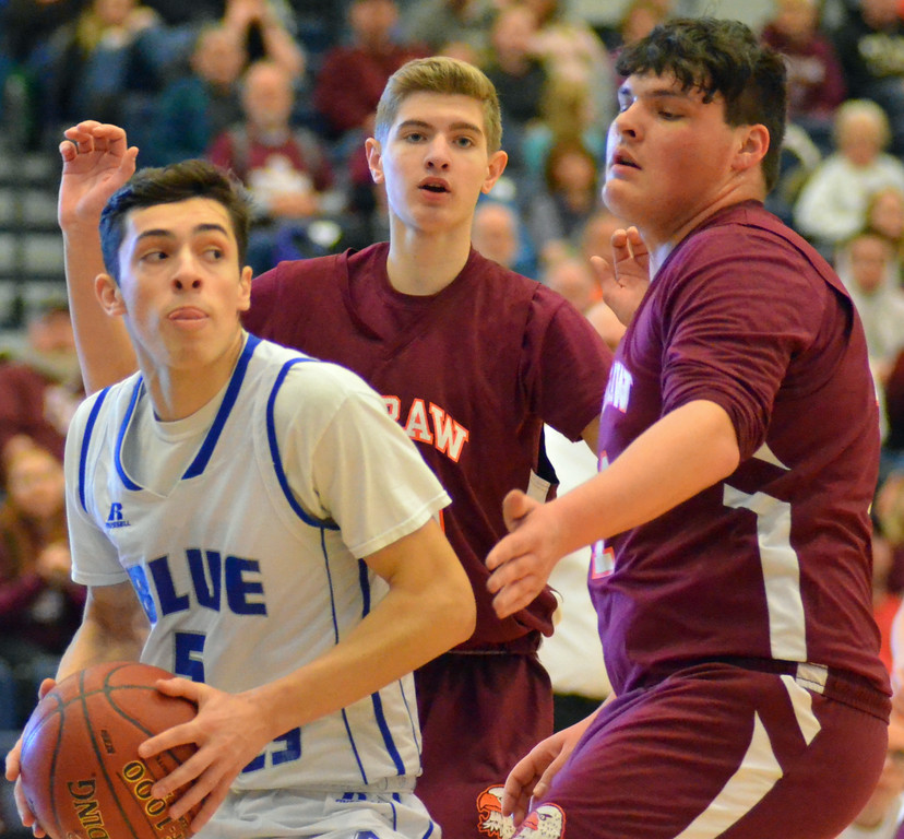 . KYLE MENNIG - ONEIDA DAILY DISPATCH Madison\'s Spencer Haviland (5) drives into the lane in as McGraw\'s Dakota Stauber (13) and David Smith (11) defend during the Section III Class D final in Syracuse on Sunday, March 5, 2017.
