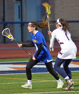 KYLE MENNIG - ONEIDA DAILY DISPATCH Cazenovia's Lauren Burbidge (1) looks to turn upfield with the ball as Liverpool's Colleen Tifft (1) defends during their game in Liverpool on Thursday, March 30, 2017.