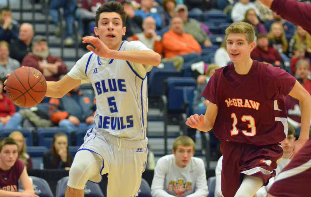 . KYLE MENNIG - ONEIDA DAILY DISPATCH Madison\'s Spencer Haviland (5) drives into the lane in front of McGraw\'s Dakota Stauber (13) during the Section III Class D final in Syracuse on Sunday, March 5, 2017.