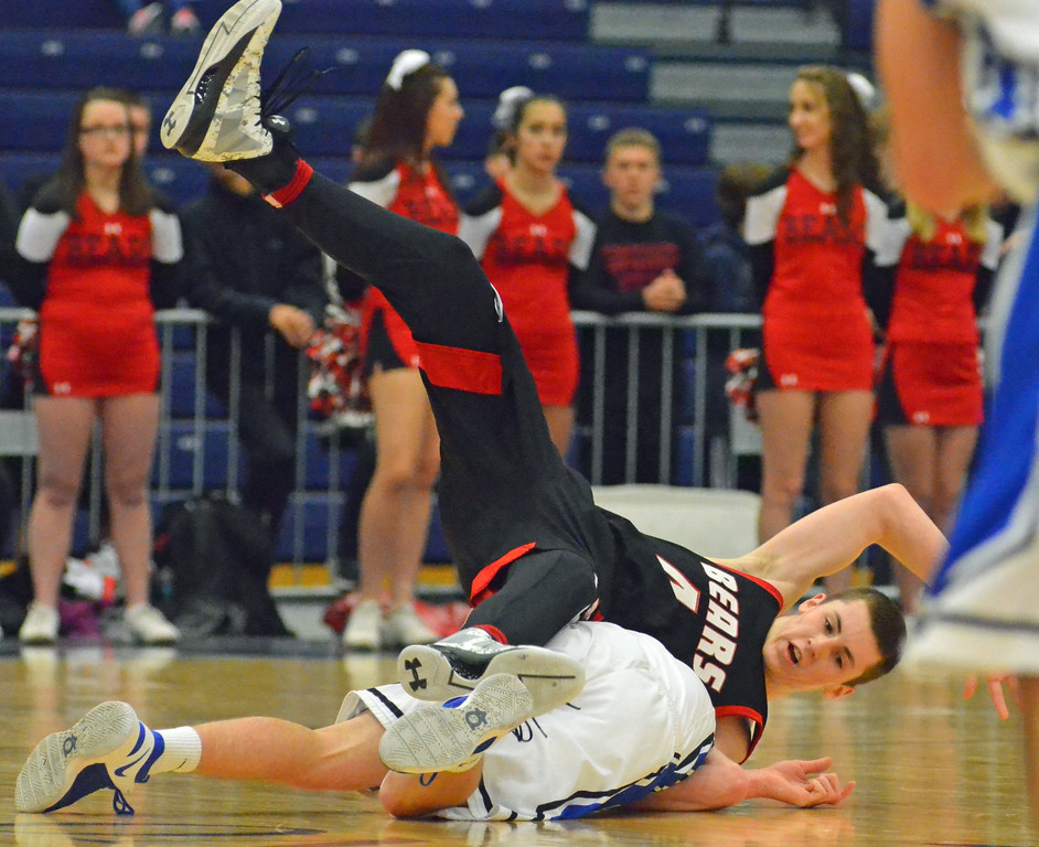 . KYLE MENNIG - ONEIDA DAILY DISPATCH Chittenango\'s Zach Falkenburg (4) dives on top of a Westhill player trying to come up with a loose ball during the Section III Class B final in Syracuse on Sunday, March 5, 2017.