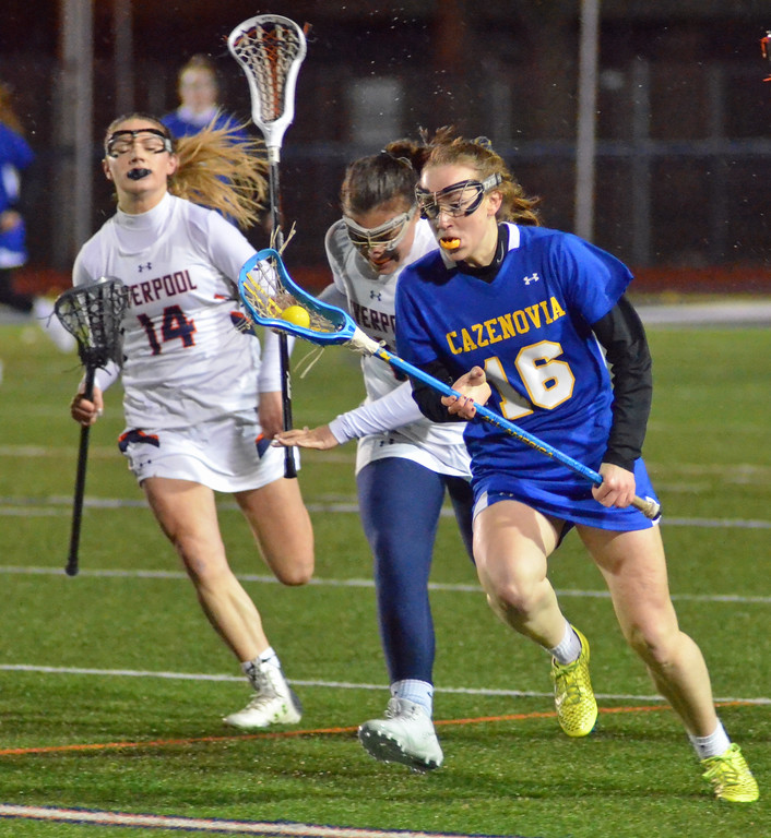 . KYLE MENNIG - ONEIDA DAILY DISPATCH Cazenovia\'s Zoe Shephard (15) brings the ball up the field in front of a pair of Liverpool defenders during their game in Liverpool on Thursday, March 30, 2017.