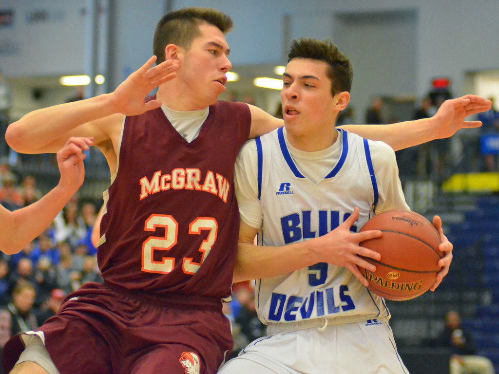 . KYLE MENNIG - ONEIDA DAILY DISPATCH Madison\'s Spencer Haviland (5) drives into the lane as McGraw\'s Jordan Cowen (23) defends during the Section III Class D final in Syracuse on Sunday, March 5, 2017.