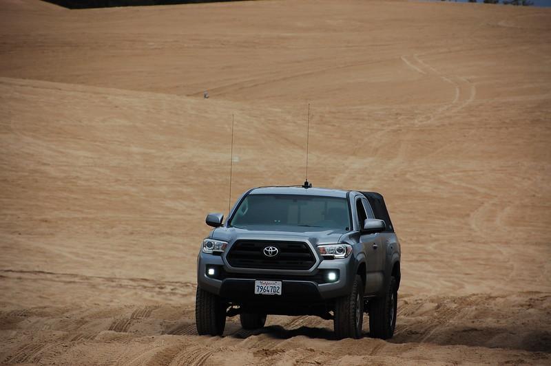 Sometimes I wish I had a passenger to photograph me doing cool shit.  I don't.  So you get this static shot of my truck in sand.  Whooo!