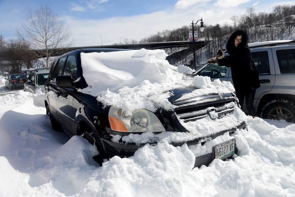 . Tania Barricklo-Daily Freeman                      Hannah Bevens of Kingston, originally of Maine, digs her car out late Wednesday morning of a municipal parking lot in Kingston, NY. Her parents , who still live in Maine, only got 9 inches.od snow.