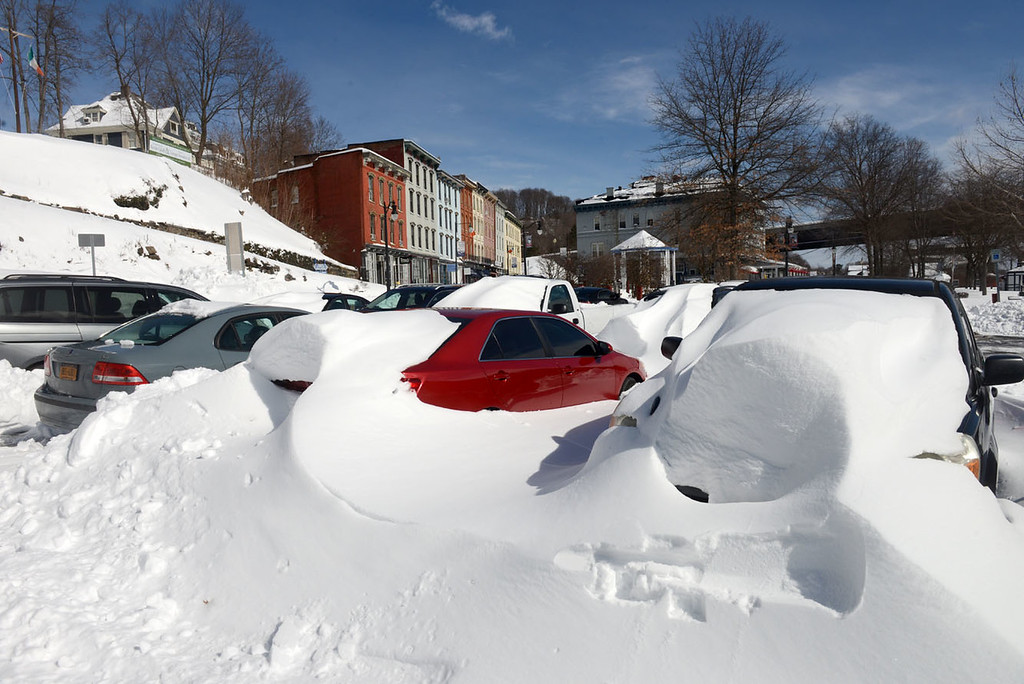 . Tania Barricklo-Daily Freeman Cars yet to be dug out of snow sit in the municpal parking lot in Kingston\'s Rondout.