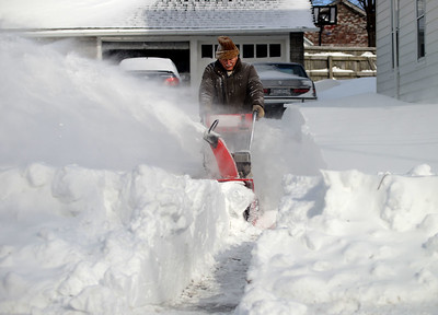 Tania Barricklo-Daily Freeman Randy Dunham uses a snowblower to dig his way out of his driveway on Henry St. Wednesday morning. nKingston, N.Y.