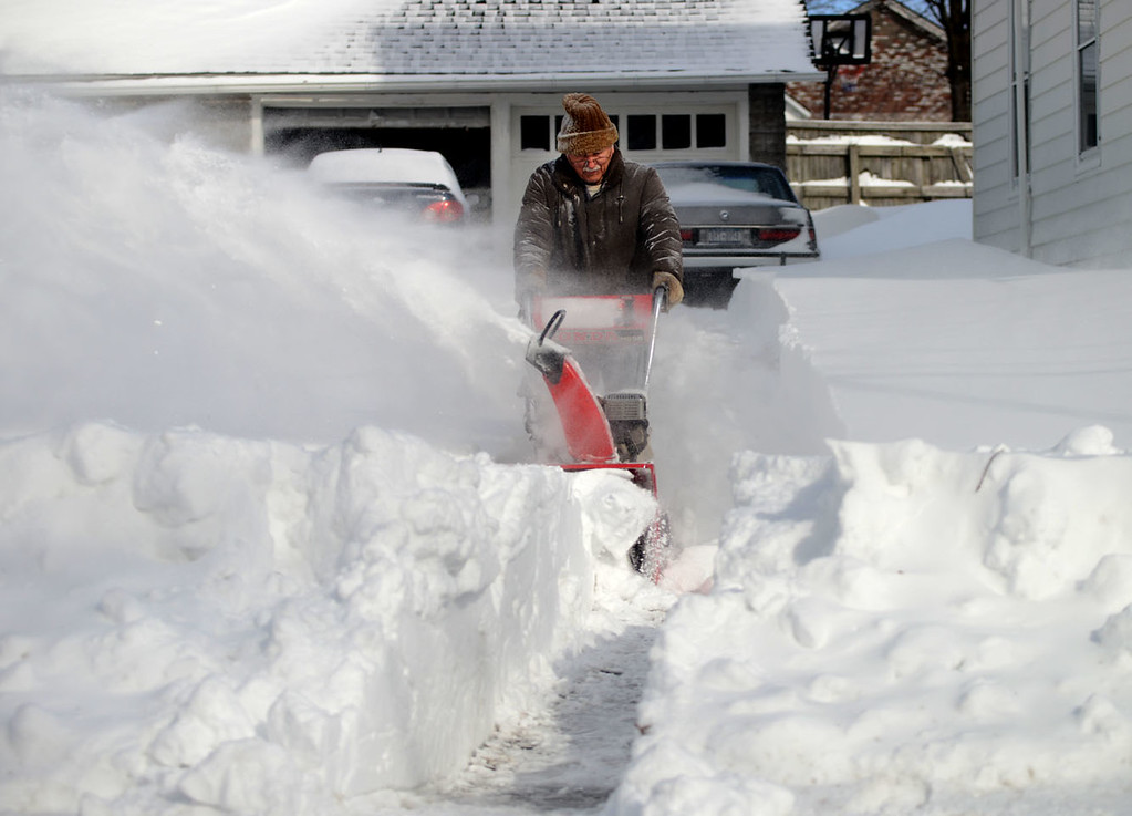 . Tania Barricklo-Daily Freeman Randy Dunham uses a snowblower to dig his way out of his driveway on Henry St. Wednesday morning. nKingston, N.Y.