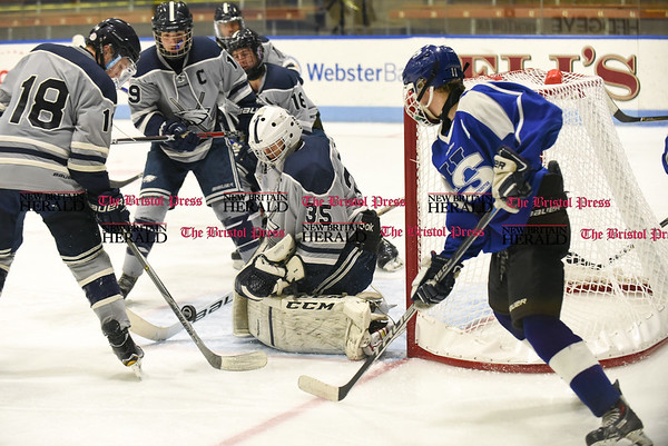 031617 Wesley Bunnell | Staff Hall-Southington hockey defeated Middletown-Rocky Hill-Plainville with a 1-0 victory in a CIAC DIII semifinal game played at Ingalls Rink Yale University on March 16, 2017. WMRP goalie Stephen Vaughan (35) with a save with H. Dustin Kilgore (11) on the right.