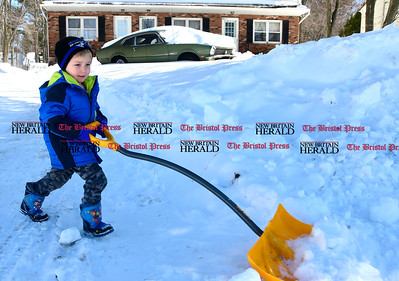 3/16/2017 Mike Orazzi | Staff Justin Hurley,4, shovels snow on Birch Street in Bristol on Thursday afternoon.