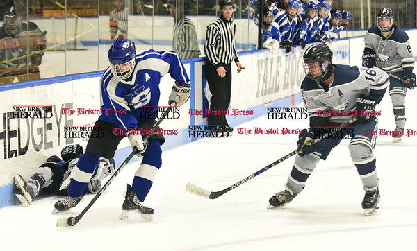 031617 Wesley Bunnell | Staff Hall-Southington hockey defeated Middletown-Rocky Hill-Plainville with a 1-0 victory in a CIAC DIII semifinal game played at Ingalls Rink Yale University on March 16, 2017. H. Dustin Kilgore (11) with the puck against WMRP's Paul Wheatley (16).