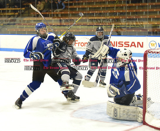031617 Wesley Bunnell | Staff Hall-Southington hockey defeated Middletown-Rocky Hill-Plainville with a 1-0 victory in a CIAC DIII semifinal game played at Ingalls Rink Yale University on March 16, 2017. Richard Mitchell IV (15) tangles with Tyler Piecewicz (19) for WMRP Zachary Monti (36) makes a save.