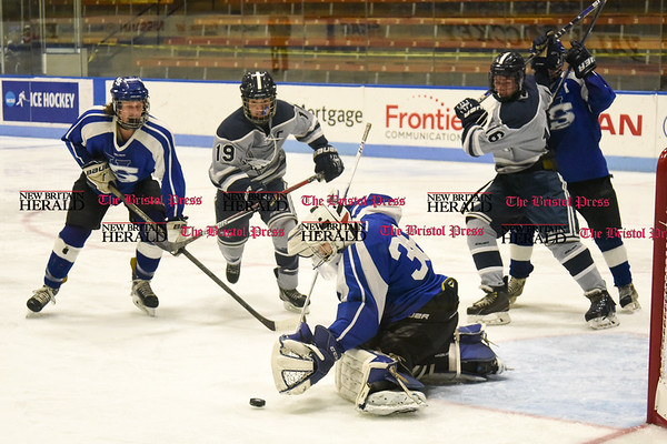 031617 Wesley Bunnell | Staff Hall-Southington hockey defeated Middletown-Rocky Hill-Plainville with a 1-0 victory in a CIAC DIII semifinal game played at Ingalls Rink Yale University on March 16, 2017. Goalie Zachary Monti (36) for Hall-Southington against WMRP's Tyler Piecewicz (19) and Paul Wheatley (16).