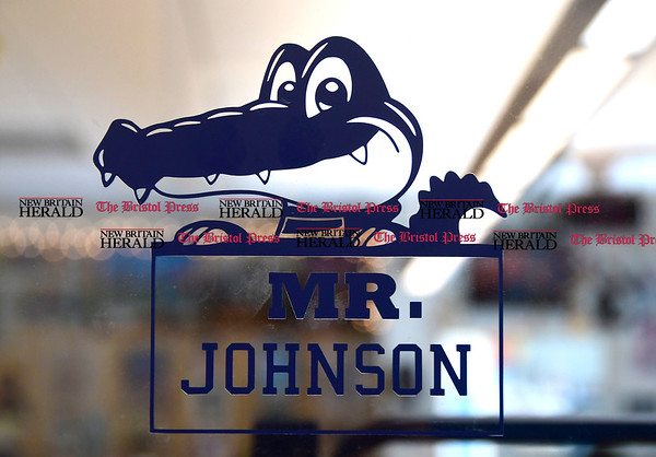 3/16/2017 Mike Orazzi | Staff Greene Hills School Art Teacher Joe Johnson's logo on his door.