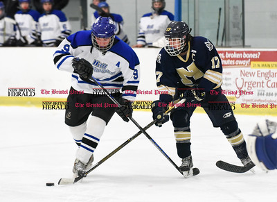 030617  Wesley Bunnell | Staff  Newington-Berlin Hockey at Hall-Southington in a Division III first round game played at Veterans Memorial Skating Rink in West Hartford. Andrew Booth (9) for Hall-Southington and Alexander Borselle (17) for Newington-Berlin.