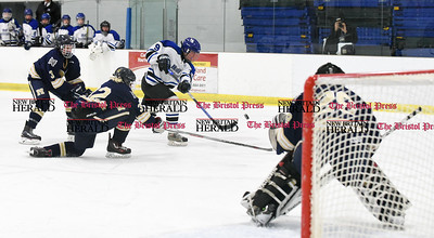 030617  Wesley Bunnell | Staff  Newington-Berlin Hockey at Hall-Southington in a Division III first round game played at Veterans Memorial Skating Rink in West Hartford. Newington-Berlin goalie Adam Belair (29) is shown as the shot from Andrew Booth (9) goes wide.